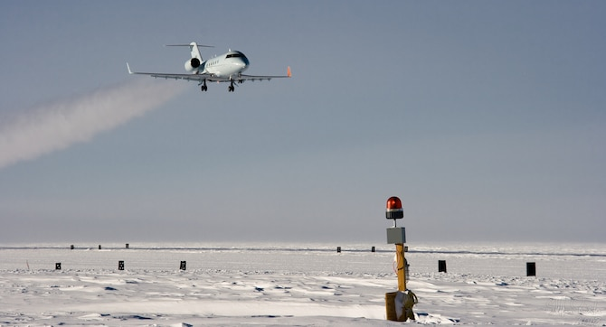 A Bombardier Challenger flown by a 1st Aviation Standards Flight crew, flies over McMurdo Station, Antarctica. The 1st ASF is a small team of reservists performing critical inspections to ensure aircraft take off and land safely in locations all around the world.  They are the only teams in the world qualified to inspect McMurdo Station. (Courtesy Photo)