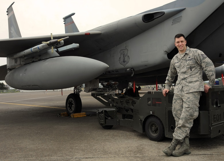 U.S. Air Force Tech. Sgt. Jordan Bigelow pauses for a photograph at the Portland Air National Guard Base, Portland, Ore., April 4, 2013. Sean Bigelow has been with the 142nd Fighter Wing for more than 10 years, working as a weapons loader on the F-15 Eagle. (Air National Guard photo by Tech. Sgt. John Hughel, 142nd Fighter Wing Public Affairs Office)