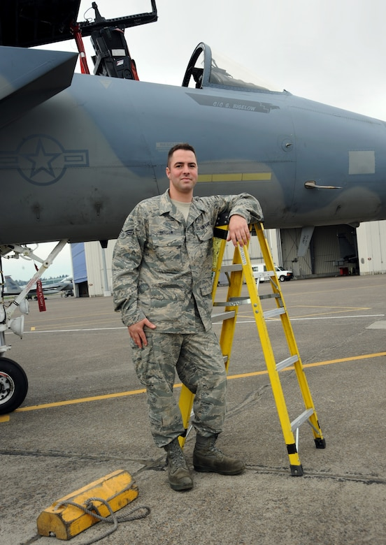 142nd Fighter Wing Senior Airman Sean Bigelow stands next to his F-15 Eagle that he maintains with the unit at the Portland, Air National Guard Base, Portland, Ore., April 4, 2013.  Sean Bigelow has been with unit for almost six years working as a crew chief. (Air National Guard photo by Tech. Sgt. John Hughel, 142nd Fighter Wing Public Affairs Office)