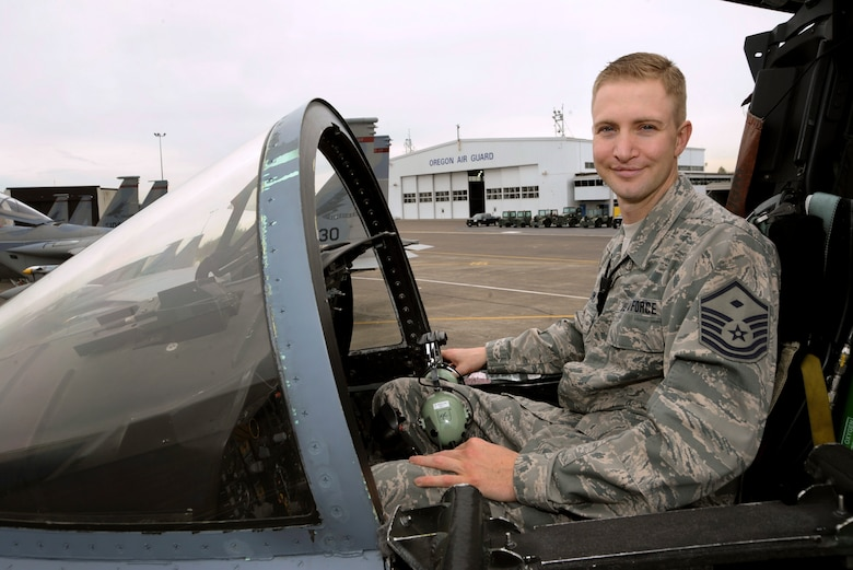 Master Sgt. Ricky Bigelow, First Sgt.and avionics maintenance technician, pauses during his work on an F-15 eagle at the Portland Air National Guard Base, Portland, Ore., April 4, 2013. Ricky Bigelow is a member of the 142nd Fighter Wing and has been with the unit for more than 13 years. (Air National Guard photo by Tech. Sgt. John Hughel, 142nd Fighter Wing Public Affairs Office)