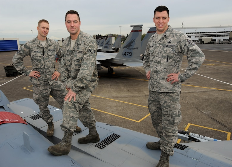 The three Bigelow bothers (left to right), Master Sgt. Ricky Bigelow, Senior Airman Sean Bigelow and Tech. Sgt. Jordan Bigelow stand together on an F-15 Eagle at the Portland Air National Guard Base, Portland, Ore., April 3, 2013.  All three brothers are members of the 142nd Fighter Wing and perform various maintenance trades on the supersonic air-to-air fighter jet. (Air National Guard photo by Tech. Sgt. John Hughel, 142nd Fighter Wing Public Affairs Office)