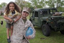 Sgt. Brenton Spriggs, 22nd Marine Expeditionary Unit headquarters commandant native of Washington D.C., carries his son Julius aboard Marine Corps Base Camp Lejeune, N.C., April 25, 2013. The 22nd MEU participated in Take Our Daughters and Sons to Work Day, an educational program in the U.S. and Canada that occurs annually on the fourth Thursday of April.