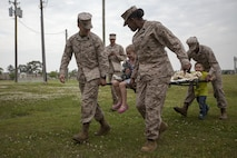 22nd Marine Expeditionary Unit Hospital Corpsmen interact with children aboard Marine Corps Base Camp Lejeune, N.C., April 25, 2013. The 22nd MEU participated in Take Our Daughters and Sons to Work Day, an educational program in the U.S. and Canada that occurs annually on the fourth Thursday of April.