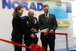 WASHINGTON, D.C. – Michèle Flournoy, Under Secretary of Defense for Policy; Air Force Gen. Gene Renuart, North American Aerospace Defense Command and U.S. Northern Command commander; and Ambassador Gary Doer, Ambassador of Canada to the United States, cut the ribbon, officially opening the NORAD Corridor Exhibit during a ceremony at the Pentagon April 28. 