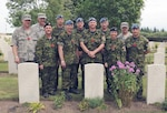 GROESBEEK CANADIAN WAR CEMETERY, The Netherlands – Corporal Dale Ogilvie (middle front), a member of the North American Aerospace Defense Command team from Colorado Springs, Colo., and his team take the time to hold a minute of silence at the grave site of his great uncle. The Canadian Forces Contingent participating in the 94th annual International Four Days marches Nijmegen visited Groesbeek Canadian War Cemetery in the Netherlands. Comprised of 189 marchers, the contingent stopped over halfway through their 40 km walk on the third day of the Nijmegen Marches to pay their respects to some 2,338 Canadian soldiers and airmen who died in the battles to liberate the Netherlands in 1944 and 1945. It is tradition that on the third day of the Nijmegen Marches for the Canadian contingent to halt at he Groesbeek Canadian War cemetery for a memorial ceremony. Many CF members consider their visit to Groesbeek the most important part of the strenuous four-day march, as it represents the history, sacrifice, remembrance and the affection Canadians have received from the Dutch community since the end of World War II. 