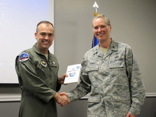 "Colonel Edward Vaughan, Air National Guard adviser to the commander and president of the Air University and co-founder of GARNET, presents ""The Startup of You,"" a professional networking book, to Brig. Gen. Jocelyn Seng, mobilization assistant to the commander and president of the Air University, following her GARNET talk at Air War College in April at Maxwell Air Force Base, Ala. (U.S. Air Force photo by Lt. Col. Patricia York)"