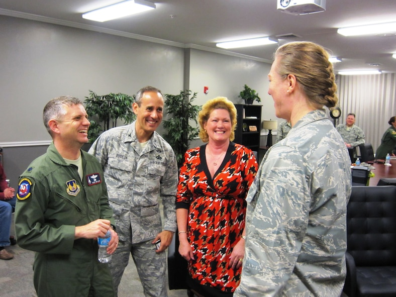 Lt. Col. Hans Miller, Air War College student; Col. Vince Bugeja, Reserve adviser to the commander of the Carl A. Spaatz Center for Officer Education; and Lt. Col. Joyce Guthrie, Public Affairs Center of Excellence, share a laugh with Brig. Gen. Jocelyn Seng, mobilization assistant to the commander and president of the Air University, following the general's GARNET talk at the Air War College in April at Maxwell Air Force Base, Ala. (U.S. Air Force photo by Lt. Col. Patricia York)