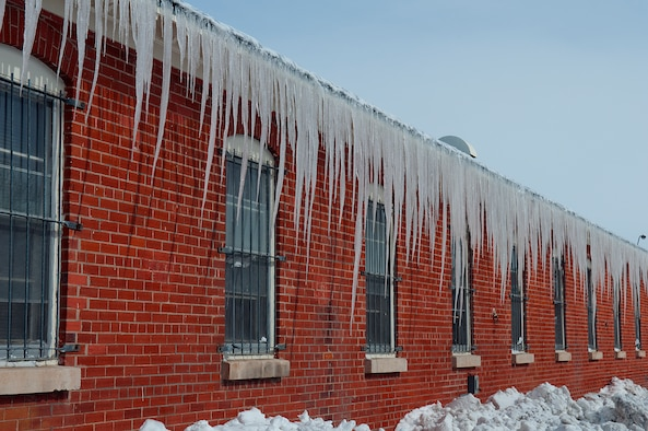Long icicles hang from the roof of a building on F. E. Warren Air Force Base April 18. A two day spring snow storm blanketed the base with more than 19 inches of  snow. (U.S. Air Force photo by R.J. Oriez)