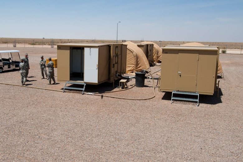 A new hygiene system is fully assembled and tested at Holloman Air Force Base, N.M., April 24. The 49th Materiel Maintenance Squadron was the first unit to receive and test the new hygiene system, complete with latrines and showers, which will eventually be utilized in forward deployed locations. The new hygiene system provides a cleaner, more private, and more durable alternative to the old systems. (U.S. Air Force photo by Airman 1st Class Daniel E. Liddicoet)