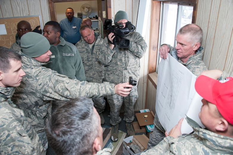Lt. Col. Thomas Niichel holds blueprints of a dorm project for members from the Air National Guard as they perform a site survey at Snow Mountain Ranch, near Winter Park, Colo., in preparation for a renovation project that will take place this summer.  Civil Engineers will be rotating in and out throughout the summer from places such as Oklahoma City, Houston, Saint Croix, U.S. Virgin Islands, and St. Josephs, MO.  Project Sanctuary is a program that currently provides therapeutic, recreational retreats to military families to help reduce the negative effects of deployment. The CE effort will vastly improve and properly equip dorms for military members during their stay.  (U.S. Air National Guard photo by Senior Master Sgt. John Rohrer)