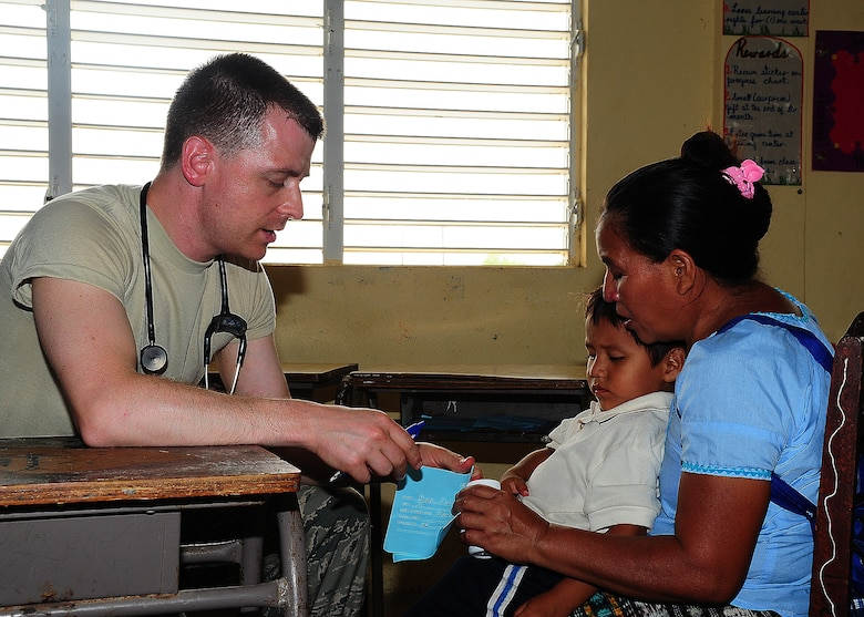 U.S. Air Force Capt. Charles Pace, pediatrician from Maxwell AFB, Ala., explains home remedies to a Belizean woman at the Independence Primary School, Belize April 16, 2013. Medical professionals from the U.S. and Canada are providing free medical treatment at multiple medical readiness training exercises throughout Belize as part of an exercise known as New Horizons. The MEDRETES are designed to provide humanitarian assistance and medical care to people in several communities, while helping improve the skills of U.S. and Canadian military medical forces. (U.S. Air Force photo/Tech Sgt. Tony Tolley)