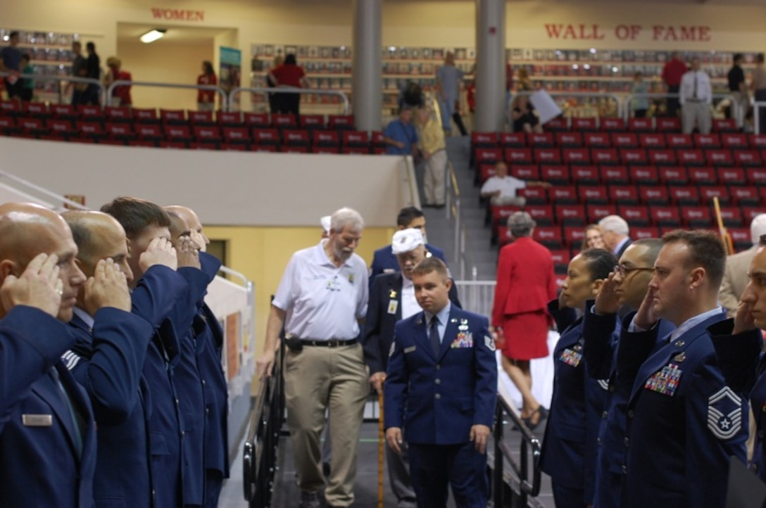 Airmen from 39th Information Operations Squadron render salutes to three Doolittle Raiders as they attend the dedication ceremony for the Doolittle Raider exhibit at the Northwest Florida State College in Fort Walton Beach, Fla., April 17, 2013. The event served as part of a week-long festivity in the Fort Walton Beach area to celebrate the 71st and final reunion of the surviving Raiders. (Courtesy photo)