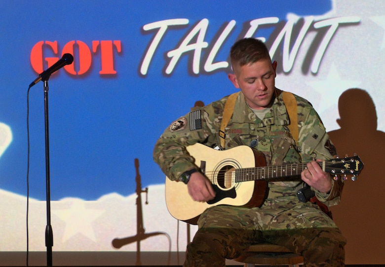 Airman First Class Jason Strong, 361st Expeditionary Reconnaissance Squadron, performs a song he wrote for the Kandahar's Got Talent competition at Kandahar Air Field April 24. Strong, who has been at Kandahar for less than a week, placed second in the competition. (U.S. Air Force photo by Capt. Brian Maguire)