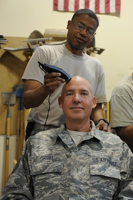 Staff Sgt. Gary Godby, 386th Expeditionary Civil Engineering Squadron has his head shaved by Staff Sgt. John Ewing at the 386th Air Expeditionary Wing, Southwest Asia Apr 25, 2013. Staff Sgt Gary Godby, 386th Expeditionary Civil Engineering Squadron organized the event to show his support for Noah and his family during his battle with cancer. (U.S. Air Force photo by Senior Master Sgt. George Thompson)