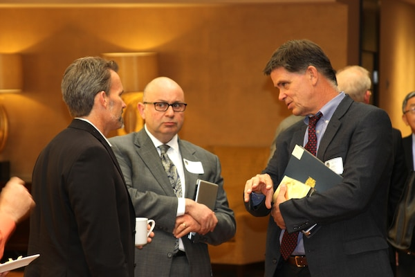 John Keever (right), chief of Construction Division at the Corps' Los Angeles District, discusses potential Corps project with attendees at a break during the Business Opportunities Forum held April 25 at the LA Hotel Downtown. Nearly 100 members of the Society of American Military Engineers attended the forum.