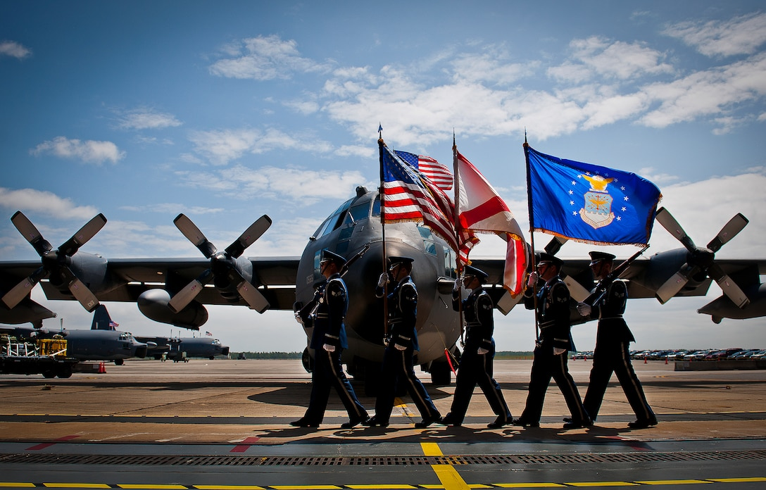 """The Eglin Honor Guard brings in the colors in the shadow of an MC-130E Combat Talon I during its retirement ceremony at Duke Field, Fla., April 25.  Aircrew, maintainers and many others turned out to remember and bid farewell to the Talon I on its official retirement from the Air Force.  The last five Talons, located at Duke Field, will be delivered to the """"boneyard"""" at Davis-Monthan Air Force Base, N.M., by mid-May 2013.  (U.S. Air Force photo/Tech. Sgt. Samuel King Jr.)"""
