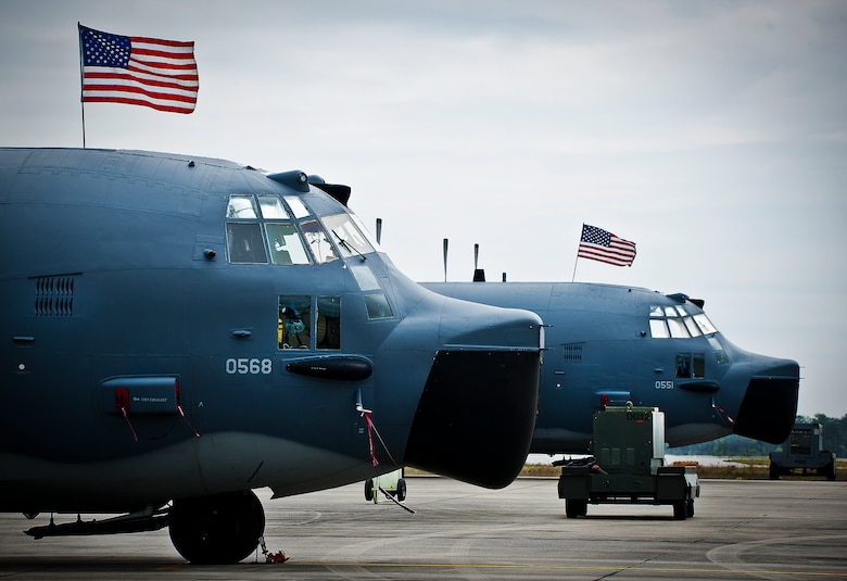 "Two of the last five MC-130E Combat Talon Is sit on the Duke Field flightline adorned with American flags for the aircraft's retirement ceremony April 25.  Aircrew, maintainers and many others turned out to remember and bid farewell to the Talon I on its official retirement from the Air Force.  The last five Talons, located at Duke Field, will be delivered to the ""boneyard"" at Davis-Monthan Air Force Base, N.M., by mid-May 2013.  (U.S. Air Force photo/Tech. Sgt. Samuel King Jr.)"