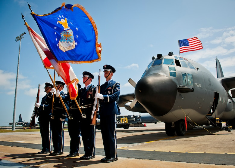 """The Eglin Honor Guard presents the colors in the shadow of an MC-130E Combat Talon I during its retirement ceremony at Duke Field, Fla., April 25.  Aircrew, maintainers and many others turned out to remember and bid farewell to the Talon I on its official retirement from the Air Force.  The last five Talons, located at Duke Field, will be delivered to the """"boneyard"""" at Davis-Monthan Air Force Base, N.M., by mid-May 2013.  (U.S. Air Force photo/Tech. Sgt. Samuel King Jr.)"""