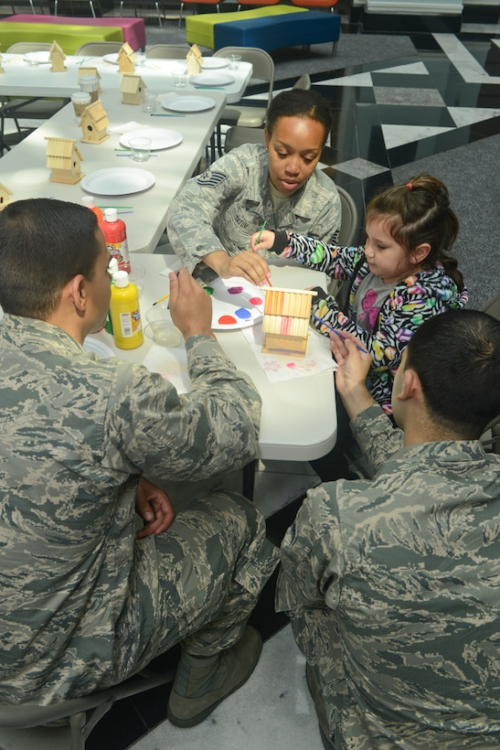 Members of the 136th Airlift Wing, Texas Air National Guard visit children at the Cook Children's Health Care System, Fort Worth, Texas, to spend time with special-needs children, April 27, 2013. The children were invited to paint bird houses for fun as a distraction from their hospital visit. (Air National Guard photo by Master Sgt. Charles Hatton/Released)