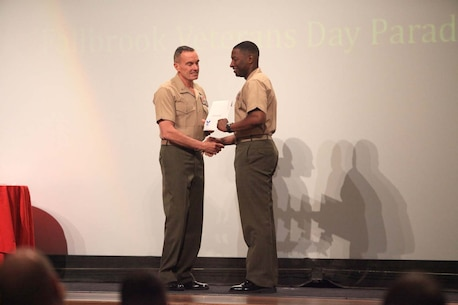 Lt. Col. Ahmed Williamson, the commanding officer of 9th Communication Battalion, I Marine Expeditionary Force, receives the Small Unit Volunteer of the Year award on behalf of his battalion at the Volunteer Recognition Ceremony at Camp Pendleton, Calif., April 25. The 9th Comm. Bn., Marines accumulated more than 3,200 hours of service while volunteering with Fallbrook Veterans of Foreign Wars, Magdalena Ecke Family YMCA, and various community outreach programs.