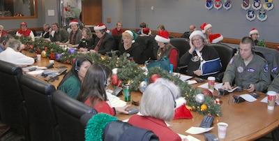 Volunteers answer phone calls at the NORAD Tracks