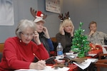 PETERSON AIR FORCE BASE, Colo. - Volunteers take calls from children at the NORAD Tracks Santa Operations Center Dec. 24, 2011. More than 1,200 volunteers in the 23-hour NORAD Tracks Santa operations center answered nearly 102,000 calls this year from children looking for Santa Claus (up over 20,000 from 2010). Volunteers ranged from Peterson AFB family members volunteering their time to First Lady Michelle Obama, who for the second year, answered NORAD Tracks Santa calls from Hawaii. (U.S. Air Force photo by Tech. Sgt. Thomas J. Doscher)