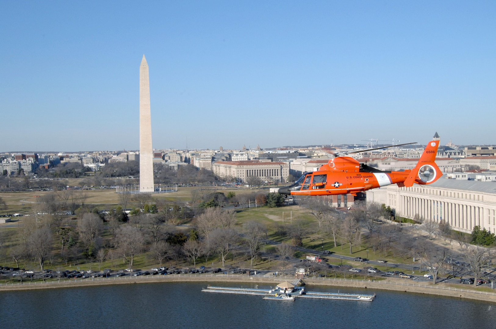 WASHINGTON, D.C. - A Coast Guard MH-65 Dolphin helicopter from Coast Guard Air Defense Facility Washington, D.C. flies by the Lincoln Memorial during a training flight Jan. 31. The unit's mission is to keep small general aviaiton aircraft from entering the area of downtown Washington, D.C. The helicopters and crews come from Coast Guard Air Station Atlantic City, N.J., and rotate in and out of the air defense mission on a regular basis. The Coast Guard has performed this mission since it first stood up in 2006.   (U.S. Air Force photo by Tech. Sgt. Thomas J. Doscher)
