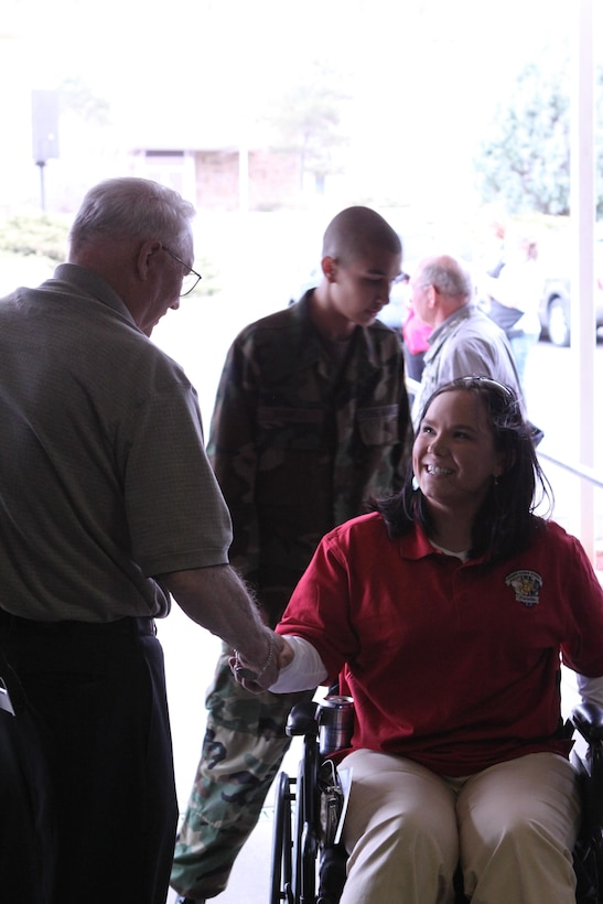 Cpl. Breanna Dill, a native of Saint Francis, Minn., and member of the Wounded Warrior Battalion West is welcomed to Colorado by members of the Veterans of Foreign Wars. Dill and 49 other Marines are here for the All-Marine Warrior Games team two-week training camp. The camp will prepare the athletes for the fourth annual Warrior Games that will be held at the Olympic Training Center and Air Force Academy in Colorado Springs, Colo., May 10-16. The Marines will continue to train hard for the remaining week and are looking forward to defending their first place title against the Army, Navy /Coast Guard, Air Force and SOCOM.  (Photo by Aquita Brown)