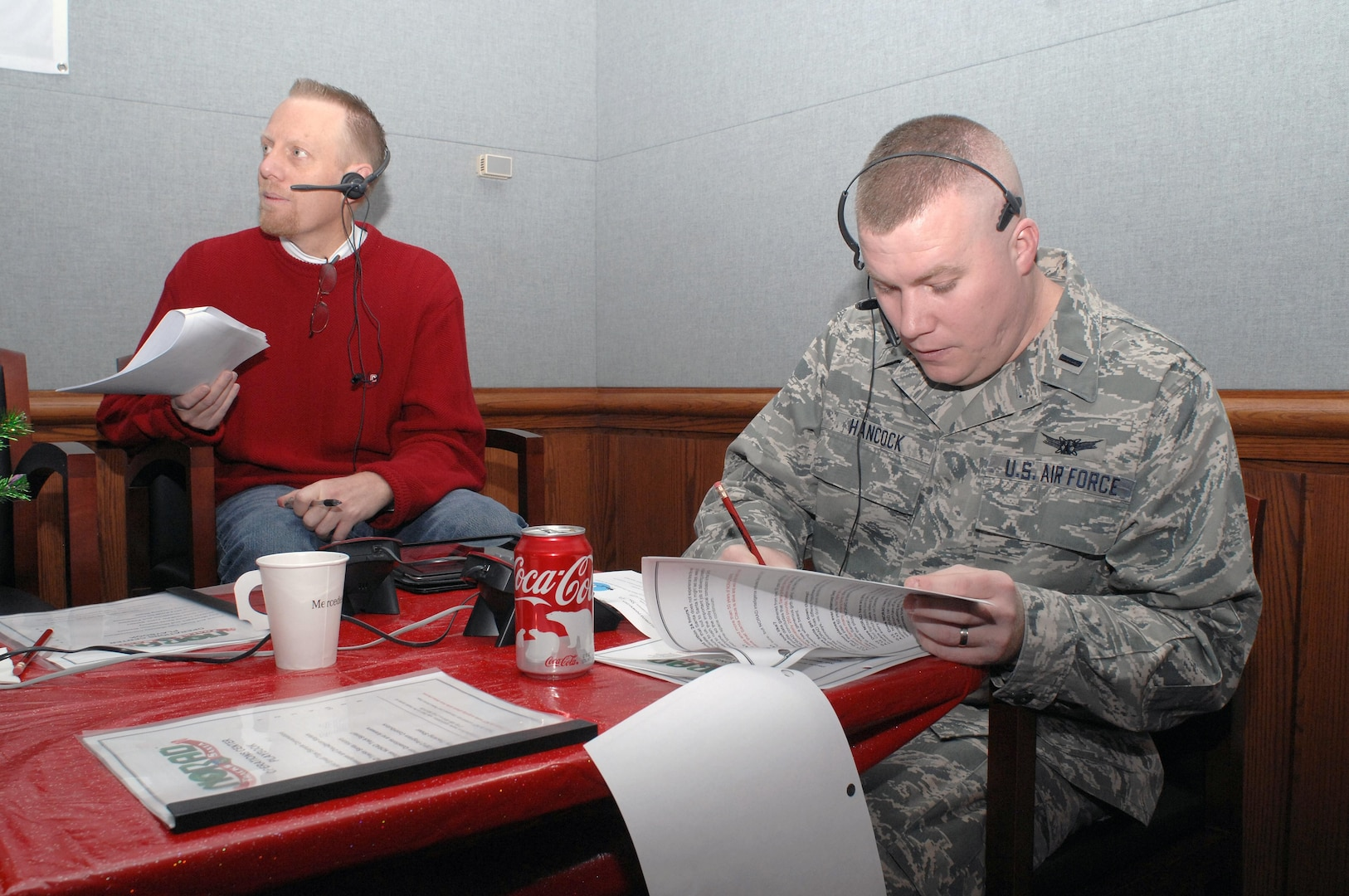 PETERSON AIR FORCE BASE, Colo. - 1st Lt. Jeremy Hancock, 21st Operations Support Squadron, takes a call while volunteering at the NORAD Tracks Santa Operations Center Dec. 24. More than 1,200 volunteers took more than 114,000 phone calls during the 24 hour period that NORAD tracked Santa in 2012. (U.S. Air Force photo by Tech. Sgt. Thomas J. Doscher)