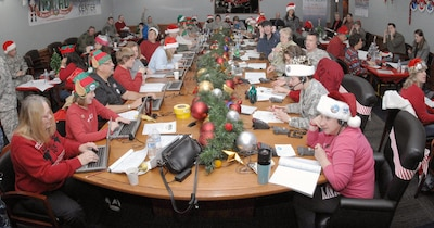 Volunteers for NORAD Tracks Santa answer phone calls