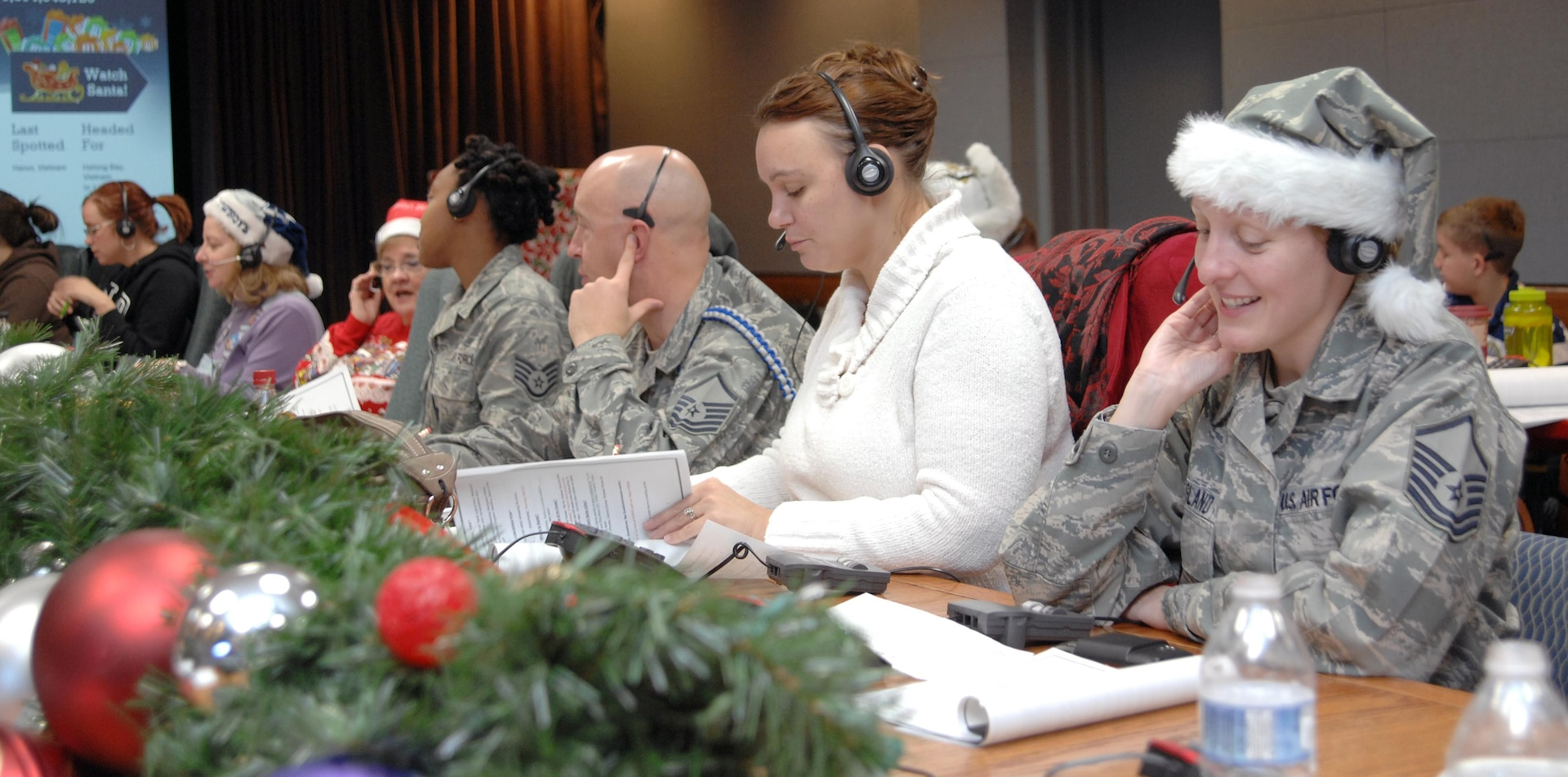 PETERSON AIR FORCE BASE, Colo. - Volunteers for NORAD Tracks Santa take calls at the NTS Operations Center Dec. 24, 2012. More than 1,200 volunteers took over 114,000 calls over a 24-hour period. (U.S. Air Force photo by Tech. Sgt. Thomas J. Doscher)