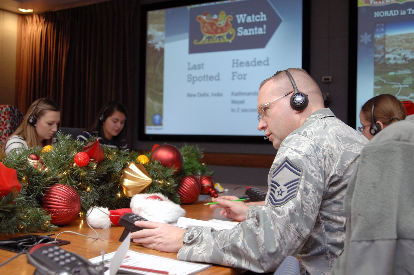 PETERSON AIR FORCE BASE, Colo. - Senior Master Sgt. Christopher Kozel, NORAD and USNORTHCOM J34, takes calls at the NORAD Tracks Santa Operations Center Dec. 24, 2012. Volunteers from every U.S. and Canadian military branch came out to volunteer during the 24 hours NORAD tracked Santa. (U.S. Air Force photo by Tech. Sgt. Thomas J. Doscher)