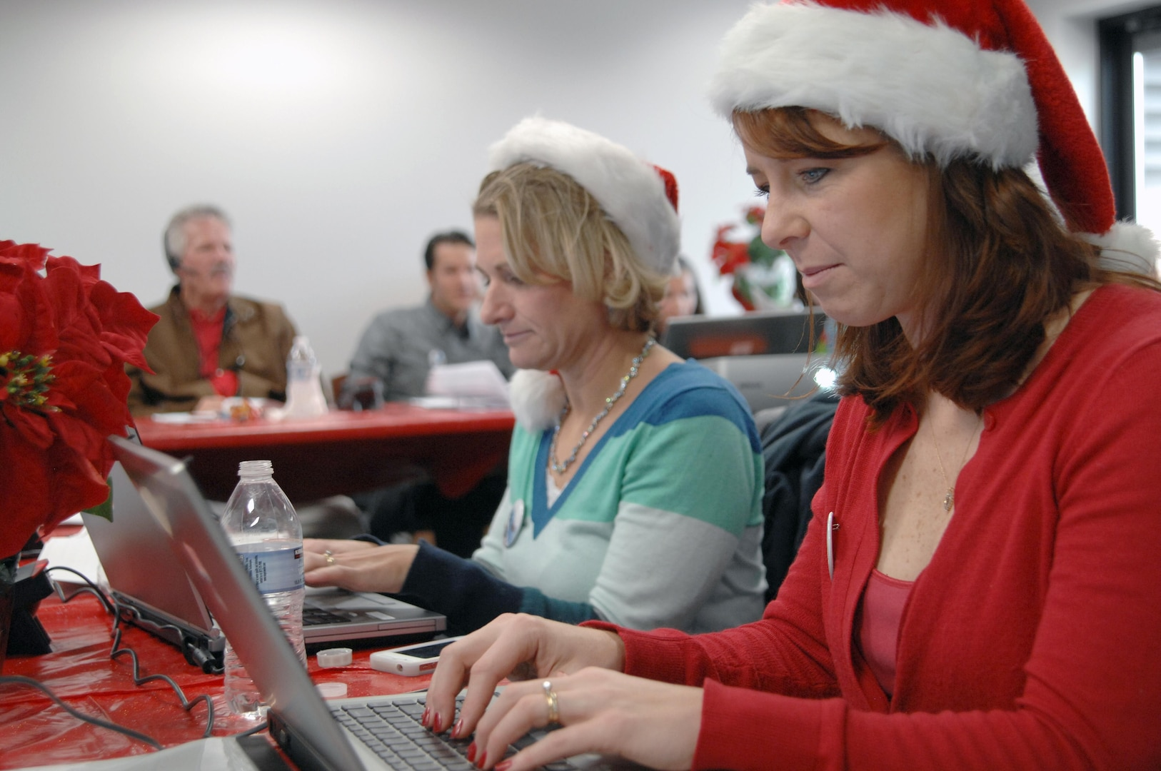 PETERSON AIR FORCE BASE, Colo. - NORAD Tracks Santa volunteers answer emails from Santa trackers across the globe at the NORAD Tracks Santa Operations Center Dec. 24, 2012. Although calling on the phone is the traditional way of contacting NORAD Tracks Santa, volunteers also answered more than 7,000 emails from people looking for Santa. (U.S. Navy photo by LCDR Bill Lewis)