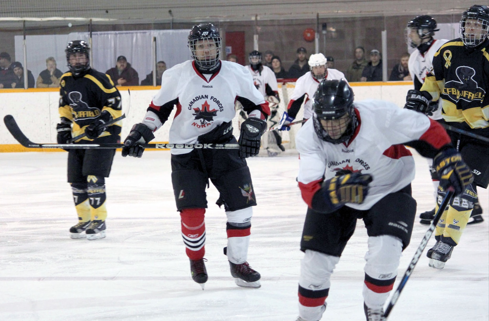 CANADIAN FORCES BASE SUFFIELD, Canada - NORAD's hockey team beat Canadian Forces Base Suffield 7-1 in the final game of the 2013 Annual Canadian Forces Prairie Region Small Base Hockey Championship Feb. 7. The NORAD team, drawing from units across North America, beat the rival team from Suffield in front of a packed house on Suffield's own ice.   (Courtesy photo)