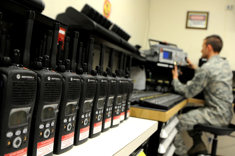 As more than 400 new radios arrived from National Guard Bureau on Apr. 24, Staff Sgt. Sean Bryson, from the 124th Communications Flight, finishes the final preparation on the encrypted radios by inspecting and testing every radio before issuing and distributing the radios to units on Gowen Field. Bryson tests power, frequency error, receive sensitivity, modulation and threshold squelch. (U.S. Air Force photo by Tech. Sgt. Becky Vanshur)