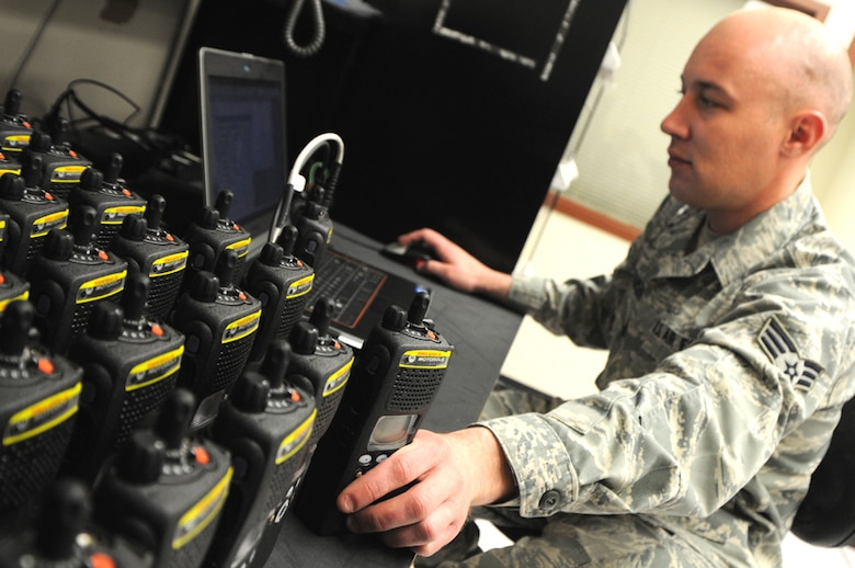 As more than 400 new radios arrived from National Guard Bureau on Apr. 24, Senior Airman Aaron Christiansen, from the 124th Communications Flight, prepares with the first stage of programming the radios with frequencies, ip addresses, Over the Air Rekeyeing and global parameters. (U.S. Air Force photo by Tech. Sgt. Becky Vanshur)