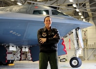Capt. Jennie Sweichowicz, 393rd Bomb Squadron B-2 Spirit pilot, poses next to a B-2 at Whiteman Air Force Base, Mo., April 23, 2013. Sweichowicz has been a pilot for 10 years. (U.S, Air Force photo by Airman 1st Class Shelby R. Orozco/Released)