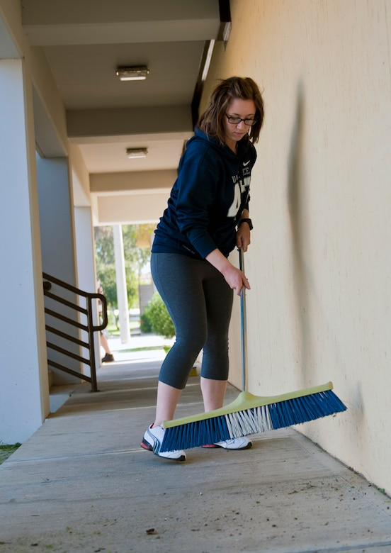 Airman 1st Class Hanna Klemann, 39th Security Forces Squadron member, sweeps debris off a pathway as part of the second annual Dorm Spring Cleaning April 26, 2013, at Incirlik Air Base, Turkey. The shared efforts of dorm residents resulted in a complete cleaning of the dorms. (U.S. Air Force photo by Senior Airman Daniel Phelps/Released)