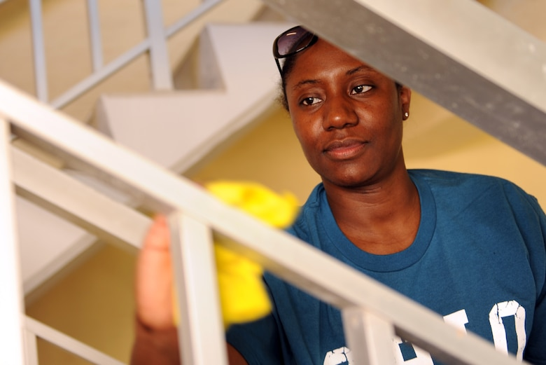 Tech. Sgt. Jameliah Brooks, 39th Maintenance Squadron administrator, cleans the rails of a stairway in the dorms as part of the second annual Dorm Spring Cleaning April 26, 2013, at Incirlik Air Base, Turkey. The cleaning was held as way to for Airmen to take care of the dorms as a team. (U.S. Air Force photo be Senior Airman Daniel Phelps/Released)