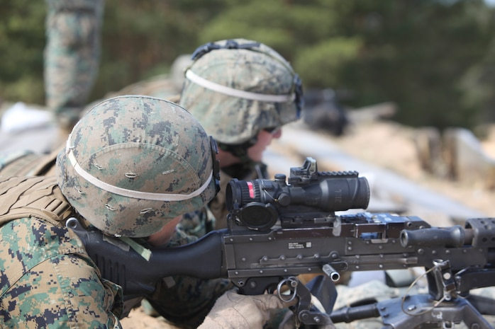 U.S. Marines and sailors with Black Sea Rotational Force 13 conduct live fire during exercie Summer Shield 10 aboard Camp Adazi, Latvia, April 24, 2013.  Exercise Summer Shield 10 focuses on integration of fires and maneuver in a joint environment to build partner nation capacity while enhancing our interoperability between the United States, Lithuania, Estonia, and Latvia. (U.S. Marine Corps photo by SSgt David Rakes, Sr./released)