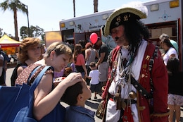 Morris Pike, also know as Captain Book, helped give away free books to children during the 18th annual Kids First Fair hosted