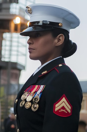 Cpl. Frances Durden, a ceremonial hoster with Marine Barracks Washington, D.C., stands her post at the main gate during a Friday Evening Parade at the Barracks April 26.