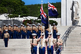 A Marine color guard from 3rd Marine Regiment carries the Australian and New Zealand Colors at the ANZAC Day ceremony here April 25. Every year, the Australian Consulate and New Zealand Embassy join with U.S. Marine Corps Forces, Pacific, to host a commemoration ceremony.
