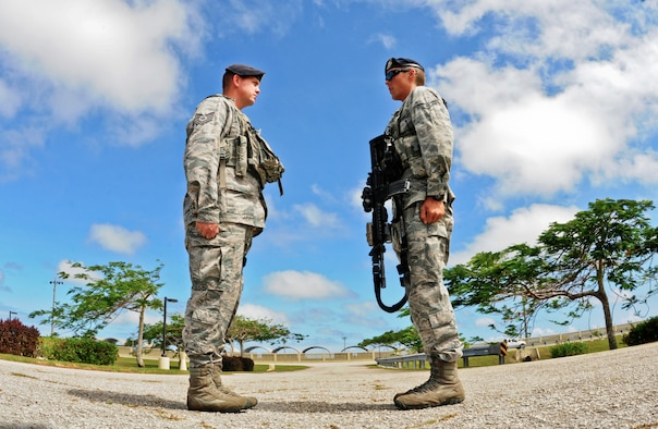 Airman 1st Class Sawyer Fox (right), 36th Security Forces Squadron Law Enforcement and Security alpha flight patrol member, reports to Tech. Sgt. Justin Traylor, 36th SFS Law Enforcement and Security alpha flight sergeant, during a post visit on Andersen Air Force Base, Guam, April 24, 2013. A flight sergeant is charged with coordinating all security and law enforcement duties for their shift and is required to be on scene for all incidents. (U.S. Air Force photo by Airman 1st Class Marianique Santos/Released)