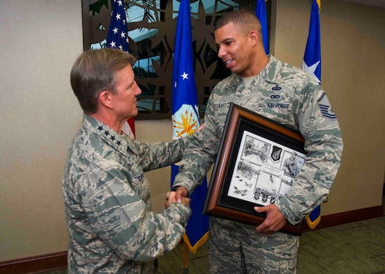 Gen. Hawk Carlisle, Pacific Air Forces commander, presents a plaque to Master Sgt. Tim Stewart, Network Control Center section lead, 374th Communications Squadron, Yokota Air Base, Japan, for his selection as one of PACAF's twelve Outstanding Airmen of the Year April 22, 2013, at Joint Base Pearl Harbor-Hickam, Hawaii.  Stewart's selection distinguishes him from his peers by exceptional performance in the following areas: leadership and job performance in primary duty, significant self-improvement and base or community involvement. (U.S. Air Force photo/Staff Sgt. Nathan Allen)