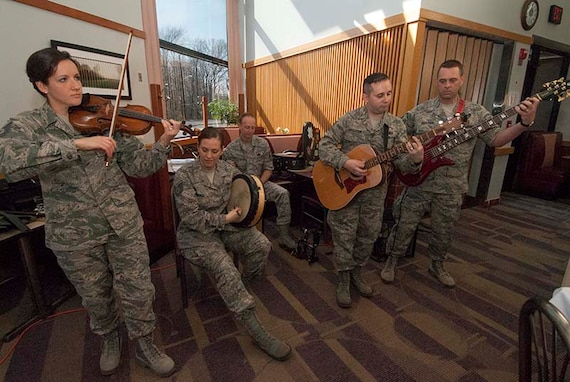 Members of The U.S. Air Force Band's Celtic Aire perform during a special Deployed Spouses Meal at Freedom Hall Dining Facility on Joint Base Andrews, Md. April 6, 2013. The free meal was held in honor of family members of deployed service members and included music, a face painting station and a visit from McGruff the Crime Dog, the National Crime Prevention Council's crime-prevention bloodhound character. (Photo/Bobby Jones)