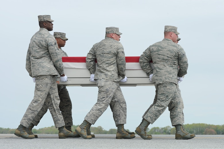 A U.S. Air Force carry team transfers the remains of Staff Sgt. Daniel N. Fannin, of Morehead, Ky., during a dignified transfer April 30, 2013 at Dover Air Force Base, Del. Fannin was assigned to the 552nd Operations Support Squadron, Tinker AFB, Okla. (U.S. Air Force photo/Greg L. Davis)
