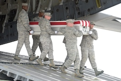 A U.S. Air Force carry team transfers the remains of Capt. Brandon L. Cyr, of Woodbridge, Va., during a dignified transfer April 30, 2013 at Dover Air Force Base, Del. Cyr was assigned to the 906th Air Refueling Squadron, Scott AFB, Ill. (U.S. Air Force photo/Greg L. Davis)