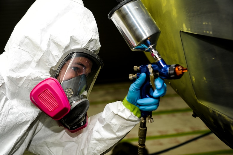 U.S. Air Force Senior Airman Timothy Jones, aircraft structural maintainer from Fabrication Flight, 1st Special Operations Equipment Maintenance Squadron, uses a paint spray gun to add lime green primer to a C-130 engine at the Corrosion Control Facility on Hurlburt Field, Fla., April 25, 2013. The primer is the main source of protection from engine corrosion. (U.S. Air Force photo/Airman 1st Class Christopher Callaway)