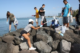 Volunteers from the U.S. Army Corps of Engineers partnered with the Waikiki Improvement Association, the Hale Koa Hotel and other concerned citizens to participate in the Waikiki Beach Clean-up on April 27 as part of Earth Day 2013.  Approximately 20 volunteers from the Punahou Junior ROTC program (which includes cadets from other area high schools and some home-schooled students) and Corps' employees and family members joined forces to clean up the beach and berm area and plant decorative plants donated by the Hale Koa Hotel at the Corps' Pacific Regional Visitor Center (RVC) at Fort DeRussy in Waikiki.  Altogether about 50 volunteers participated.  The RVC is located on the second floor of historic Battery Randolph at Fort DeRussy. Battery Randolph is listed on the National Register of Historic Sites and is one of 16 coastal fortifications built by the Corps between 1906 and 1917 for the protection of Honolulu and Pearl Harbors.